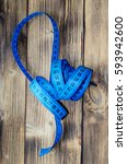 Blue Measuring Tape On A Woode...