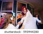 the bride with small girl... | Shutterstock . vector #593944280
