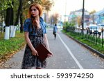 red haired girl in park sunny... | Shutterstock . vector #593974250
