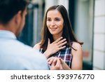 young man proposing to... | Shutterstock . vector #593976770