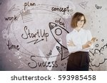 attractive young woman using...   Shutterstock . vector #593985458