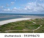 windy blavand beach with blue... | Shutterstock . vector #593998670