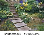 flagstone steps over pool with... | Shutterstock . vector #594003398