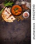 spicy chicken tikka masala in... | Shutterstock . vector #594029540