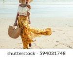 girl wearing floral maxi skirt... | Shutterstock . vector #594031748