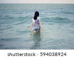 wet young asean woman play... | Shutterstock . vector #594038924