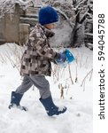 boy playing with snow in winter   Shutterstock . vector #594045788