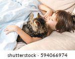 child sleeping with cat at home | Shutterstock . vector #594066974