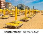 umbrellas on the beach of lido... | Shutterstock . vector #594078569