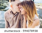 man and woman posing on the... | Shutterstock . vector #594078938