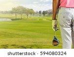 golf player holding a golf club ... | Shutterstock . vector #594080324