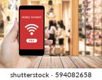 hand holding smart phone with... | Shutterstock . vector #594082658