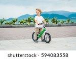 active blond kid boy driving... | Shutterstock . vector #594083558