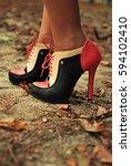 woman's black beige and orange... | Shutterstock . vector #594102410
