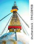Small photo of Bodhnath stupa in kathmandu with buddha eyes and prayer flags. Nepa, Kathmandu