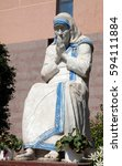 Small photo of TIRANA, ALBANIA - SEPTEMBER 27: Mother Teresa statue in front of St Paul's Cathedral in Tirana, Albania on September 27, 2016.