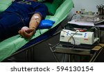 arm blood donor at donation. | Shutterstock . vector #594130154