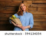 smiling cute girl in the blue... | Shutterstock . vector #594134054