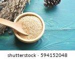 white quinoa seeds in  wooden... | Shutterstock . vector #594152048