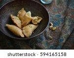 nuts and khoya stuffed 'gujhiya'... | Shutterstock . vector #594165158