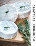 three heads of camembert cheese ...   Shutterstock . vector #594219950