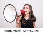 pretty girl shouting into... | Shutterstock . vector #594259328