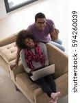 happy young african american... | Shutterstock . vector #594260039