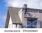 roofer assembles sheet metal on ... | Shutterstock . vector #594260864