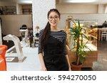 asian barmaid in eyeglasses... | Shutterstock . vector #594270050
