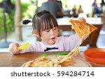 little child girl enjoy eating... | Shutterstock . vector #594284714