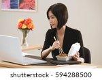 a woman eats lunch at her desk...   Shutterstock . vector #594288500