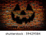 halloween jack-o-lantern on dark brick background - stock photo