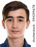 Small photo of Face of young handsome Persian teenage boy vertical close up studio shot isolated against white background isolated against white background