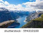 adventurous girl at trolltunga. ... | Shutterstock . vector #594310100