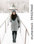 girl in a gray coat and a gray... | Shutterstock . vector #594329660