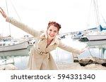 joyful young woman playful with ... | Shutterstock . vector #594331340