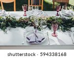 festive table served dishes and ... | Shutterstock . vector #594338168