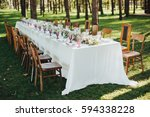 festive table served dishes and ... | Shutterstock . vector #594338228