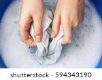 a woman washes clothes by hand... | Shutterstock . vector #594343190