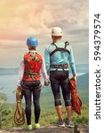 a couple of climbers with ropes ... | Shutterstock . vector #594379574