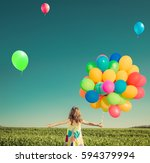 happy child playing with bright ... | Shutterstock . vector #594379994