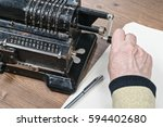 Old Wrinkled Hand Turns The...