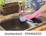 in the kitchen hand in... | Shutterstock . vector #594406520
