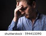 a dark portrait of a depress men | Shutterstock . vector #594413390