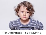 beautiful angry boy looking at... | Shutterstock . vector #594432443