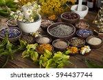 herbal medicine on wooden desk... | Shutterstock . vector #594437744