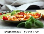 ravioli with tomato sauce and... | Shutterstock . vector #594457724