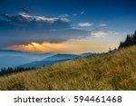 sunrise above peaks of smoky...   Shutterstock . vector #594461468