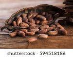 cocoa pod on wooden background | Shutterstock . vector #594518186