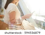 shopper with paperbags... | Shutterstock . vector #594536879